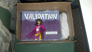 box of copies of Validation Comicon Special