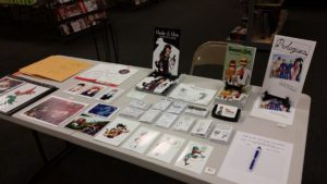 comic convention table set up