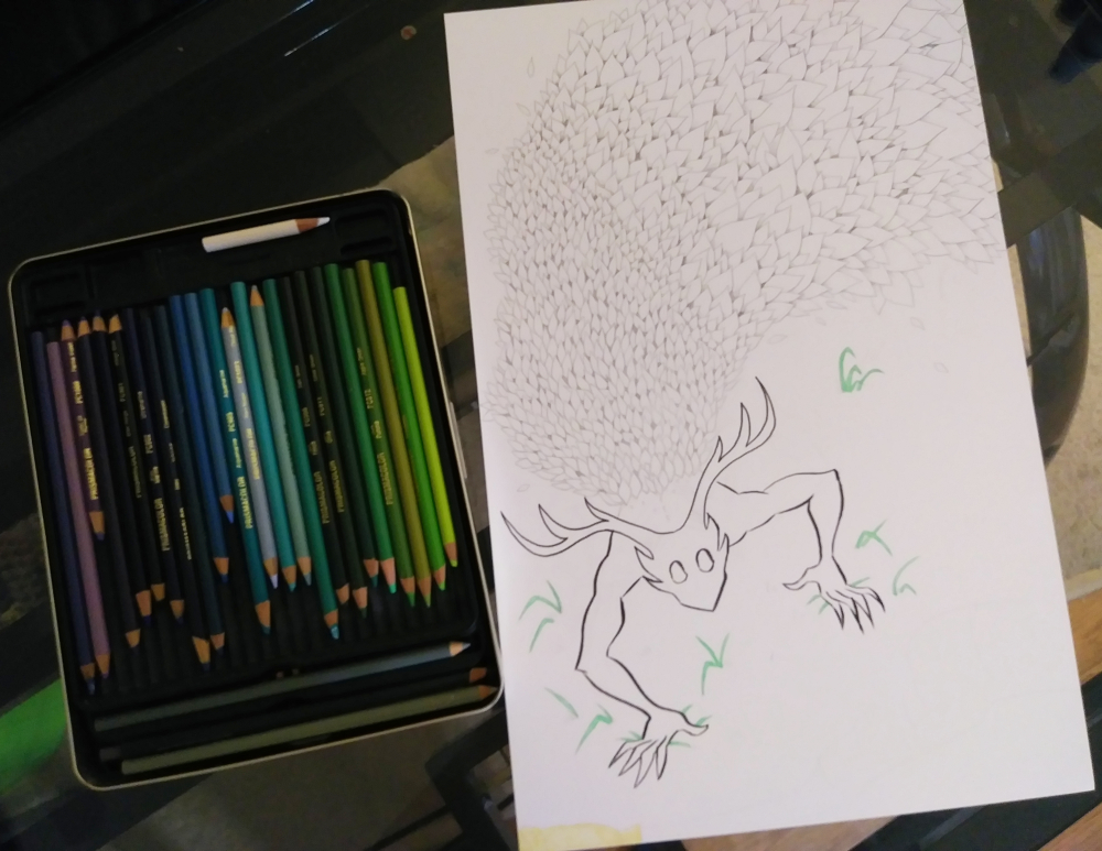 here's a picture of an art piece in progress. The 11 inch by 17 inch paper has a monster depicted whose body is mostly made of leaves. Next to the canvas is a tin full of colored pencils.